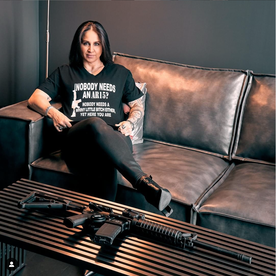 Jordana Goldlist Sitting With An AR-15
